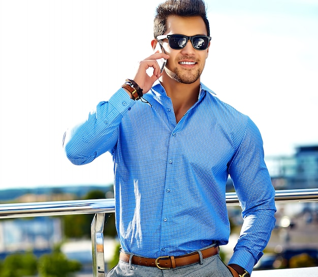 Businessman in formal clothes and sunglasses