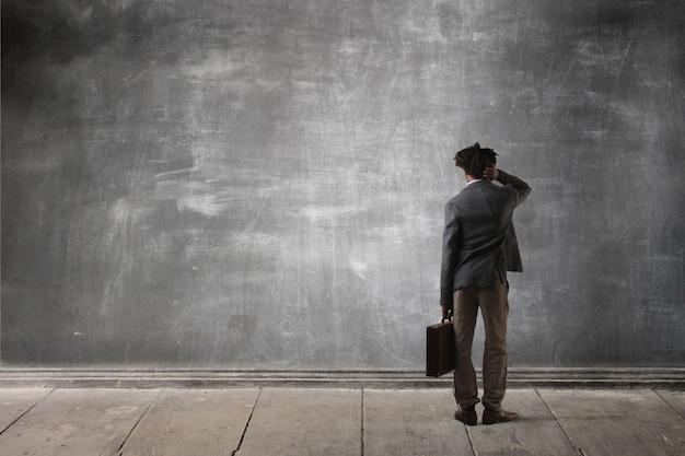 Businessman in front of a blackboard