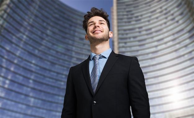 Businessman in front of a skyscraper