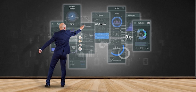 Businessman in front of a wall with user interface screens with icon, stats and data 3d rendering