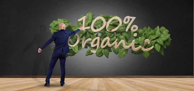 Businessman in front of a wooden logo 100% organic with leaves around 3d rendering