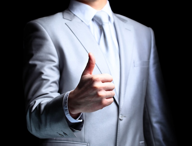 The businessman a gesture a finger