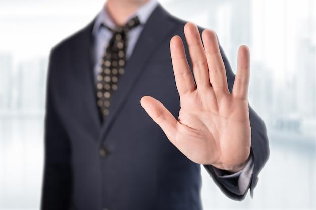 Businessman gesturing stop sign.