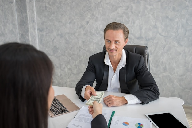 Businessman get dollar money bribery in office. corruption concepts.