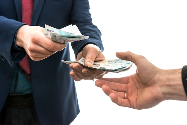 Businessman gives or takes a bribe of money