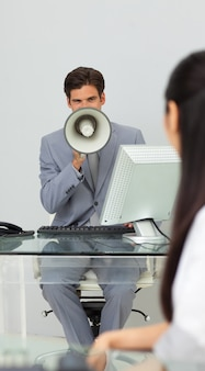 Businessman giving instructions with a megaphone