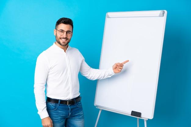 Businessman giving a presentation on whiteboard giving a presentation on whiteboard and pointing it