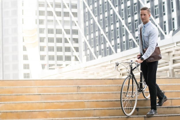 Businessman going to work by bicycle.