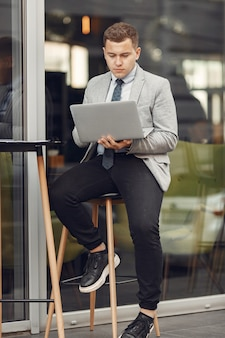 Businessman. guy in a suit. male use a laptop.