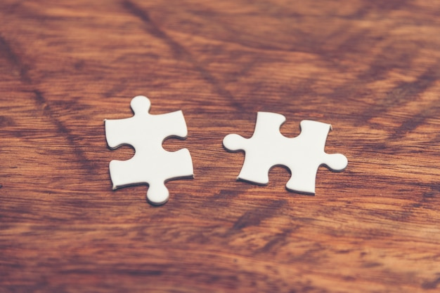 Businessman hand connecting jigsaw puzzle.