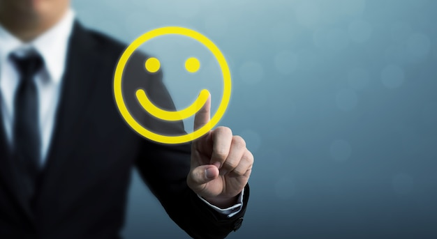 Businessman hand drawing smiley face