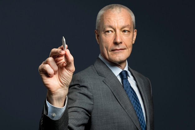 Businessman hand gesture using a stylus and writing