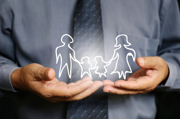 Businessman hand hold family
