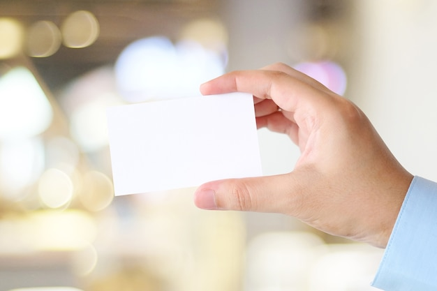 Businessman hand holding blank white business card with copy space for text