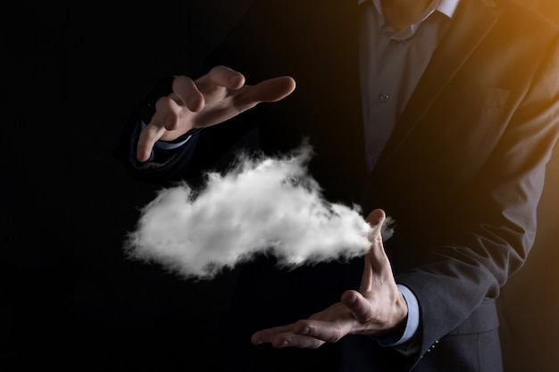 Businessman hand holding cloud. cloud computing concept, close up of young business man with cloud over his hand.the concept of cloud service.