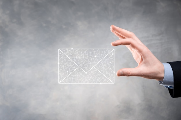 Businessman hand holding e-mail icon, contact us by newsletter email and protect your personal information from spam mail