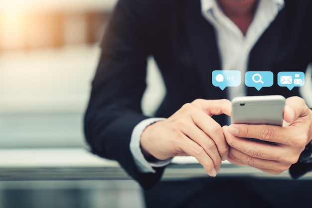 Businessman hand using mobile smartphone. business concept.