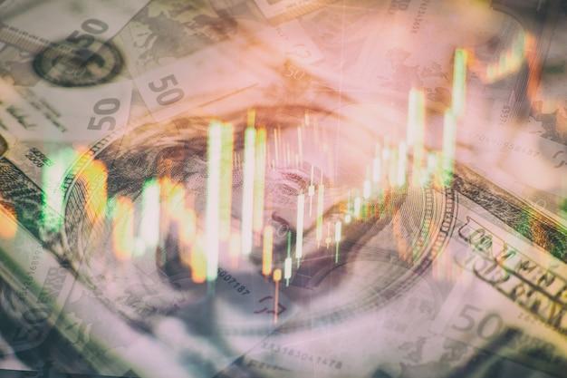 金市場、外国為替市場、トレーディング市場の投資チャートの分析に取り組んでいるビジネスマンの手。