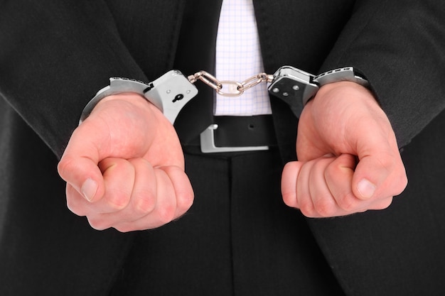 A businessman in handcuffs