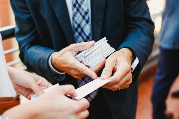 Businessman handing a business card to a colleague
