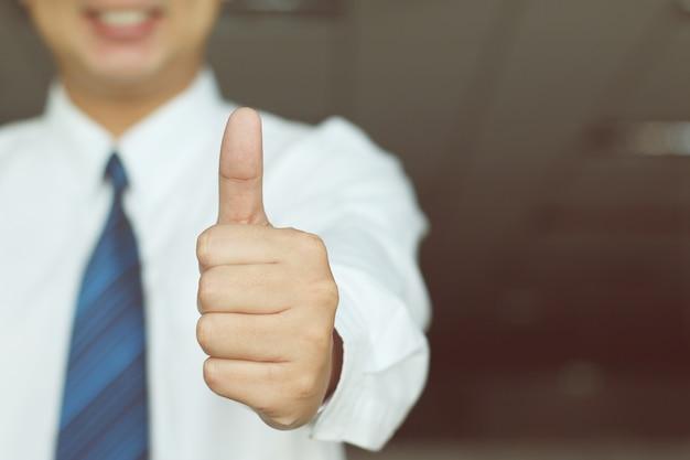 Businessman hands a great mark