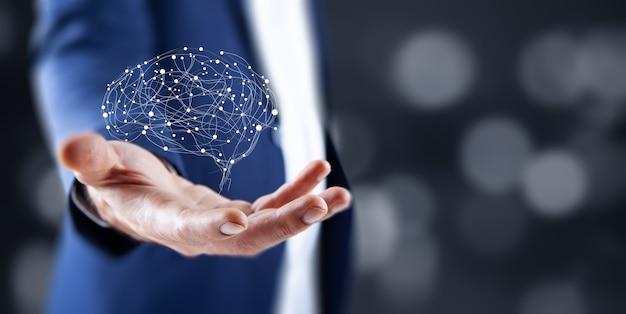 Businessman hands holding abstract polygonal brain on dark