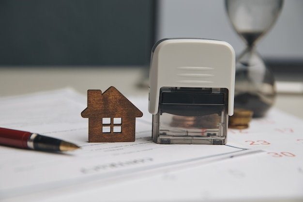 Businessman hands signing documents file paperwork financial or property mortgage real estate