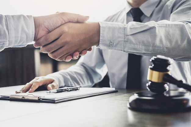 Businessman handshake male lawyer after discussing good deal of trading contract