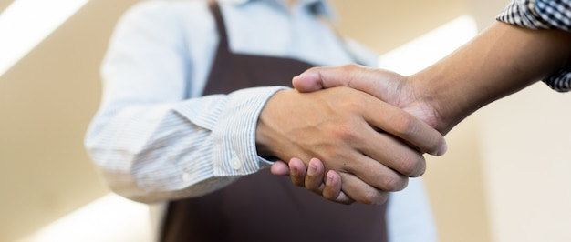 Businessman handshake with partner,ceo leader hand shake for agreement
