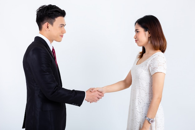 Businessman handshake with young secretary woman on white