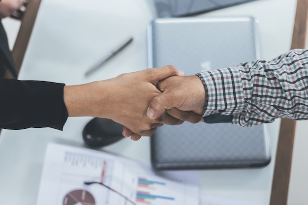 Businessman handshaking business women, happy with success agreed to work.