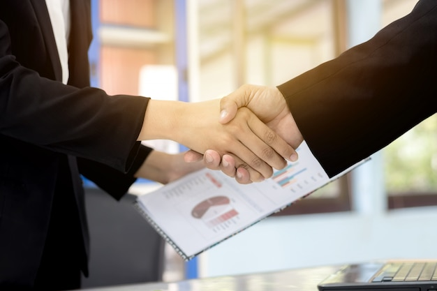 Businessman handshaking business women