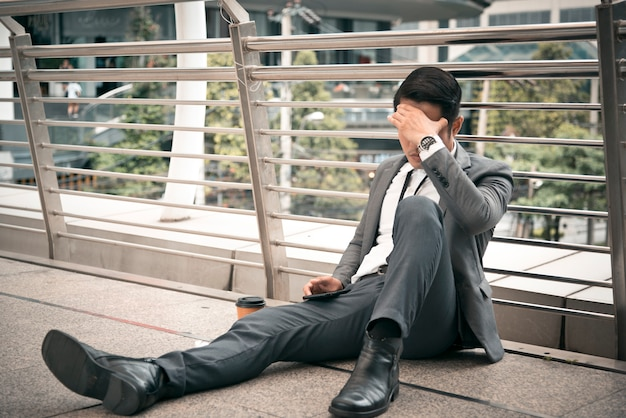 Businessman have headache and stressed, unemployed concept