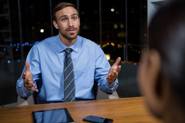 Businessman having a discussion in office