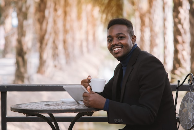 Businessman having a happy time with coffee
