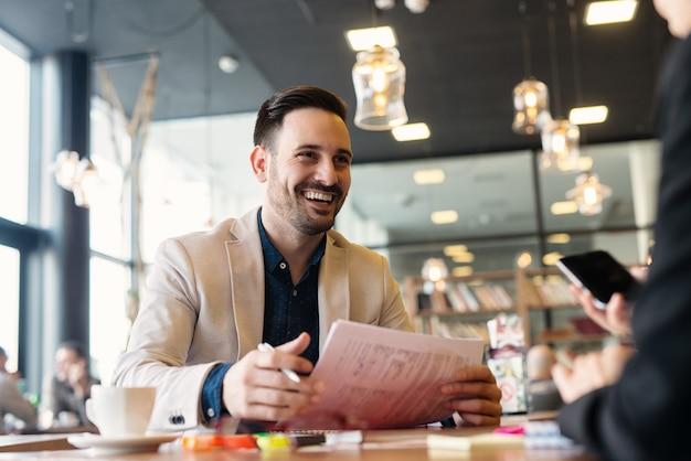 Businessman having meeting in cafe.