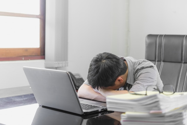 Businessman having stress with laptop computer working in the office