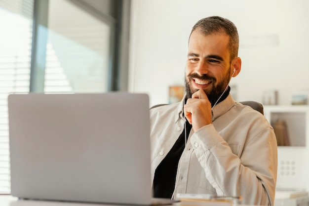 Businessman having a videocall for work