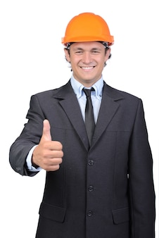 Businessman in helmet giving thumbs up.