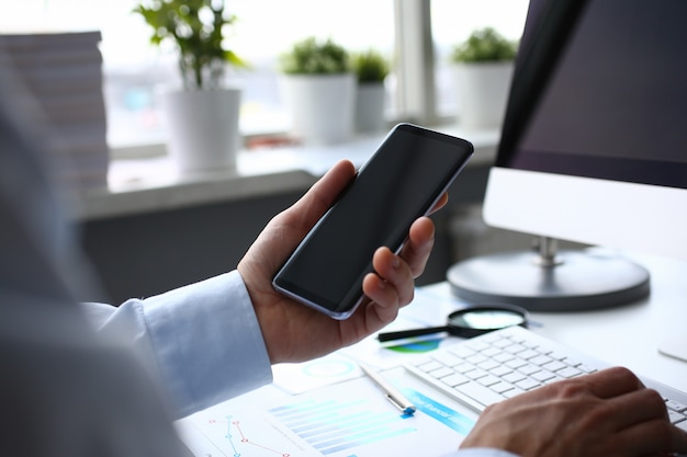 Businessman hipster holds telephone background