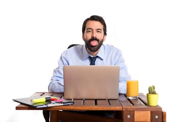 Businessman in his office doing a joke