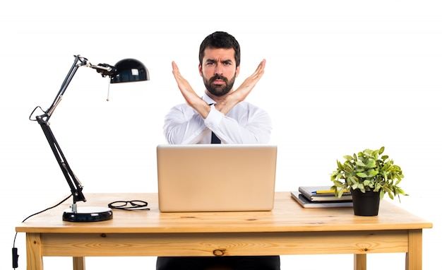 Businessman in his office doing no gesture