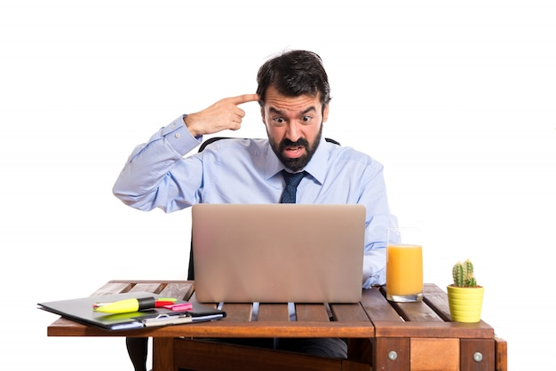 Businessman in his office making crazy gesture