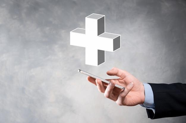 사업가 3d 플러스 아이콘을 잡고, 남자 손에 잡고 이익, 혜택, 개발, csr과 같은 긍정적 인 것을 더하기 기호로 표시