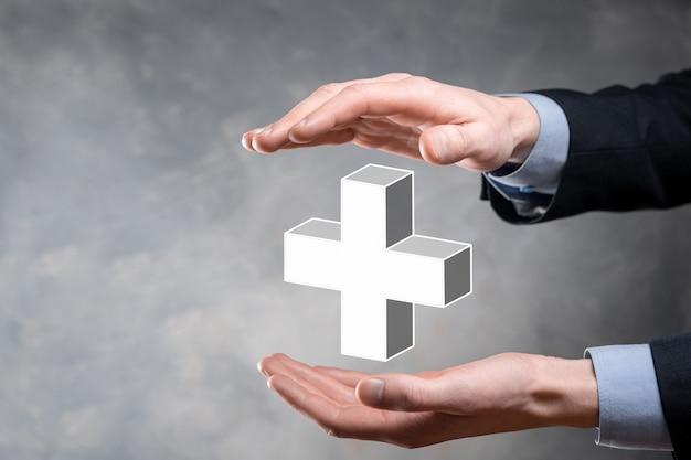 사업가 3d 플러스 아이콘을 잡고, 남자 손에 잡고 이익과 같은 긍정적 인 것을 제공