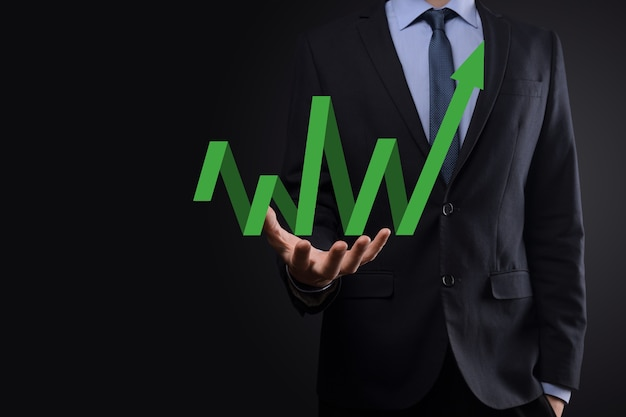 Businessman hold drawing on screen growing graph, arrow of positive growth icon.pointing at creative business chart with upward arrows.financial, business growth concept.