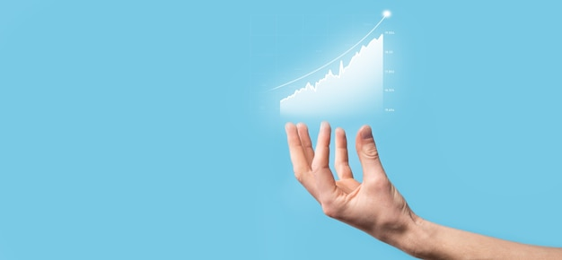 Businessman hold drawing on screen growing graph, arrow of positive growth icon.pointing at creative business chart with upward arrows.financial, business growth concept