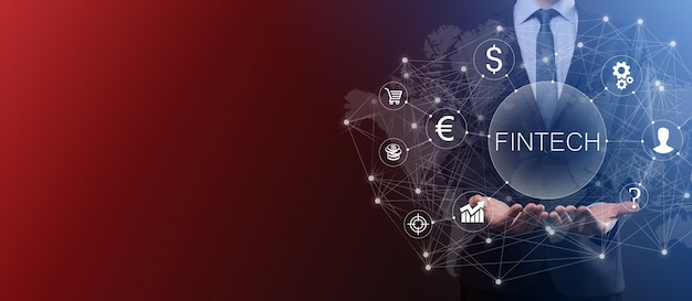 Businessman hold fintech -financial technology concept.business investment banking payment. cryptocurrency investment and digital money. business concept on virtual screen.