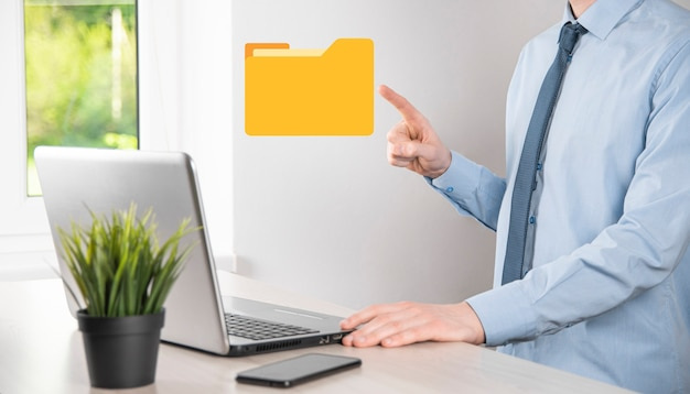 Businessman hold folder icon.document management system or dms setup by it consultant with modern computer are searching managing information and corporate files.business processing,