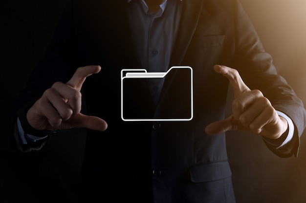 Businessman hold folder icon.document management system or dms setup by it consultant with modern